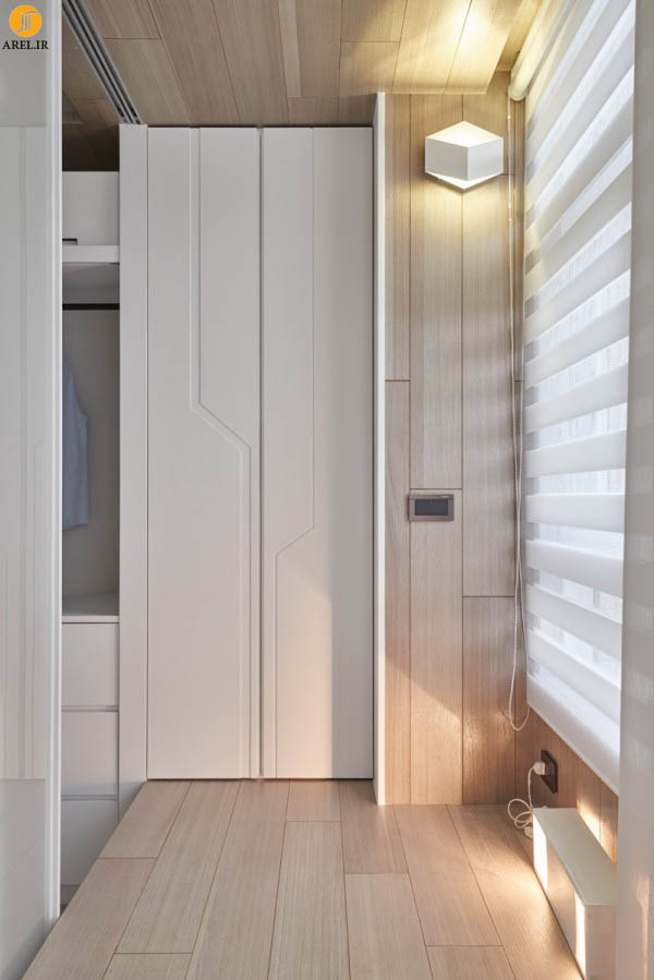 طراحی داخلی خلاقانه ی خانه ای با کمدهای فراوان و دیوارهای سفید