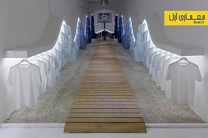 طراحی داخلی بوتیک لباس میامی با رگال های موجی شکل