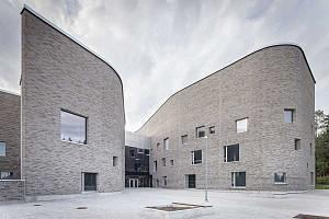 معماری ساختمان تلفیقی از یک مدرسه، کتابخانه و مهدکودک