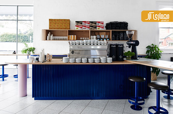 طراحی داخلی کافی شاپ mammoth با رنگ های آبی و صورتی