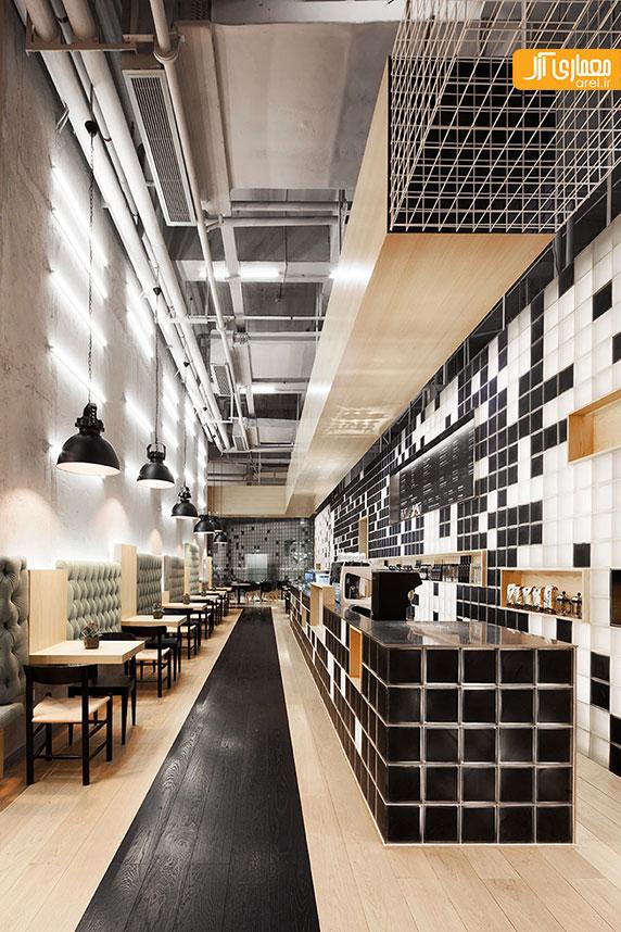 طراحی داخلی کافه gaga در کنار داربست های سبز